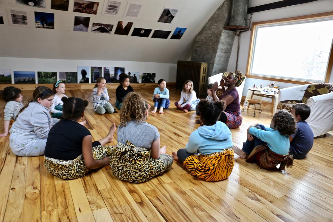 Mambo Tse teaching children
